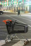 Shopping mall parking lot and empty shopping cart stock photo