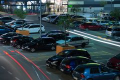 Shopping mall parking lot at night. royalty free stock photography