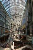 Shopping Mall in Toronto, Canada. Toronto, Canada - September 5, 2015: Inside view of a modern shopping mall (Eaton Centre) in Toronto's city centre, full of Stock Photos