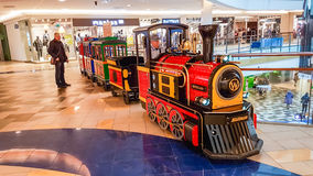 Shopping mall train for kids going. Panorama shopping mall and little train going around the shop in Vilnius, Lithuania Stock Photography