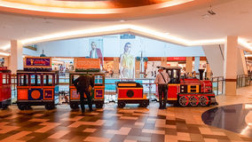 Shopping mall train for kids going. Panorama shopping mall and little train going around the shop in Vilnius, Lithuania Royalty Free Stock Photography