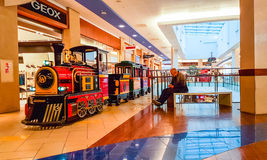 Shopping mall train for kids going. Panorama shopping mall and little train going around the shop in Vilnius, Lithuania Stock Photos