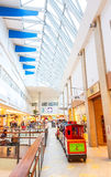 Shopping mall train for kids going. Panorama shopping mall and little train going around the shop in Vilnius, Lithuania Royalty Free Stock Image