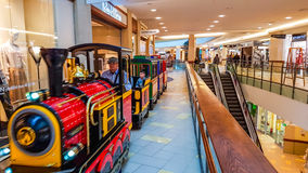 Shopping mall train. Panorama shopping mall and little train going around the shop in Vilnius, Lithuania Royalty Free Stock Images
