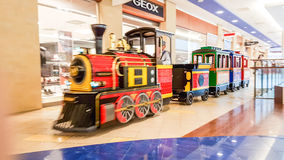 Shopping mall train, Vilnius. Panorama shopping mall and little train going around the shop in Vilnius, Lithuania Stock Image