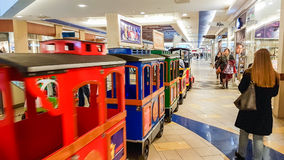 Shopping mall train, Vilnius. Panorama shopping mall and little train going around the shop in Vilnius, Lithuania Stock Photos