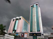 Shopping mall under dark clouds. Royalty Free Stock Photos