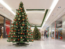 Shopping mall during xmas time. Shopping mall interior decorated with christmas trees Stock Photo