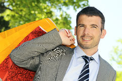 Shopping man. Great businessman outdoor with colored shopping bags Royalty Free Stock Images