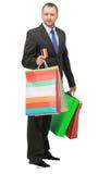 Shopping man. Happy shopping man. Isolated over white background Stock Image