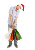 Shopping man in christmas hat Stock Photo
