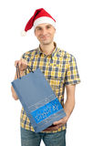 Shopping man in christmas hat Royalty Free Stock Images