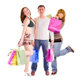 Shopping man and his two girlfriends Stock Images