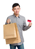 Shopping man holding paper bag and credit card Royalty Free Stock Photography