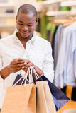 Shopping man texting Royalty Free Stock Photos