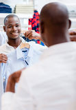 Shopping man trying on clothes Royalty Free Stock Photos