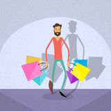 Shopping Man Walking with Shop Bags Stock Photos