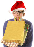 Shopping man wearing Santa hat Stock Image