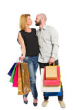 Shopping man and woman standing. Happy smiling shopping men and women standing on white background Royalty Free Stock Images