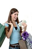 Shopping Mania. A woman armed with money and credit cards shopping Royalty Free Stock Photography