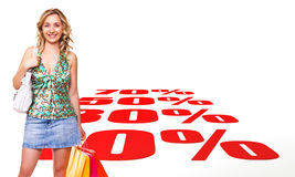 Shopping mania. Caucasian woman with shopping bag and 3d background Stock Photography