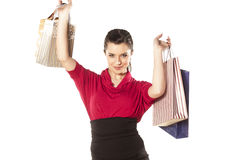 Shopping Mania. Happy and smiling blue-eyed brunette holding shopping bags on white background Stock Photos