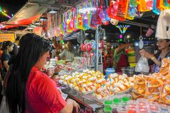 The shopping in the market coupled with women. royalty free stock images
