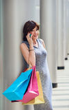 Shopping mature woman on the phone Stock Images