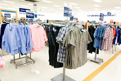 Shopping: Men's Department. Men's clothing department featuring popular brands of clothing at the bargain department store Marshall's. The fashion retail Stock Image