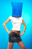Shopping metaphor. Woman with shopping bag over her head Royalty Free Stock Photo
