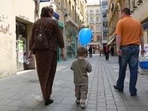 Shopping in Metz. Woman, boy with a blue balloon and a man shopping in Metz royalty free stock image