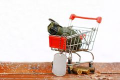 Military surplus shopping cart. Shopping for military surplus items stock photo
