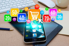 Shopping with mobile phone during sales Royalty Free Stock Photography