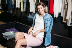 Shopping. Model brunette girl in stylish clothes, posing in clothing store, a new trend of clothes. Banner for a clothing store. stock photos