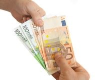 Shopping with money. Giving money for purchased goods Stock Photography