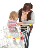 Shopping mother with baby in trolley Royalty Free Stock Photography