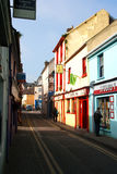 Shopping in a narrow street in Kinsale, County Cork, Ireland on the 18th March. Small shops in a small town Stock Photos