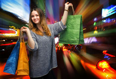 Shopping in New York City. Beautiful young woman with shopping bags during sales season in the big city Royalty Free Stock Images