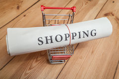 Shopping newspaper on cart Stock Image