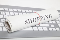 Shopping newspaper. On a keyboard royalty free stock photos