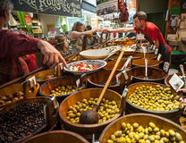 Shopping for olives Stock Images