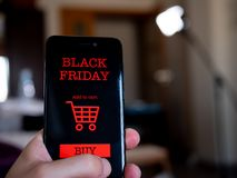 Shopping online for black friday on phone stock image