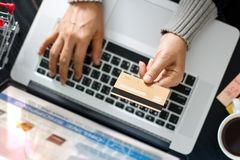Shopping online concept. Woman holding gold credit card in hand Stock Images