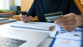 Shopping online concept. Man enters credit card information for online purchases stock video