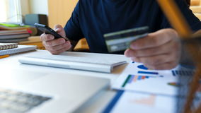Shopping online concept. Man enters credit card information for online purchases stock footage