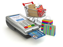 Shopping online concept. Pos terminal with credit card and shopp Royalty Free Stock Photo