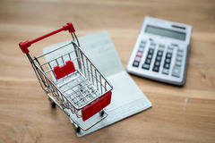 Shopping Online Concept. Mini Shopping Cart On book bank and Stock Image