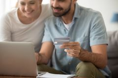 Shopping online with credit card concept, couple buying in internet royalty free stock image