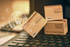 Shopping online, e-commerce concept: Cardboard boxes with icon customer network connection on keyboard. depicts of transportation