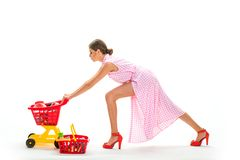 Shopping online is so easy. retro woman hurrying to buy products. under control. daily tasks.big sale in shopping mall royalty free stock images